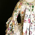Detail of the back of a robe à la française made in england from chinese painted silk, c 1770s