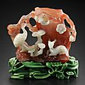 Imperial carnelian agate carved vase with ivory tainted stand, 18th century
