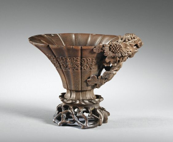 A carved rhinoceros horn 'chrysanthemum' libation cup, China, Qing dynasty, 17th-18th century