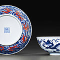 An iron-red-decorated blue and white 'dragon' dish, daoguang six-character seal mark and of the period (1821-1850)