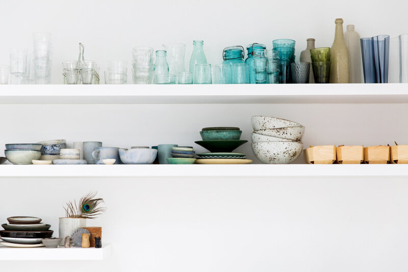 gorgeous-open-shelving-with-gradient-organization-coco-kelley