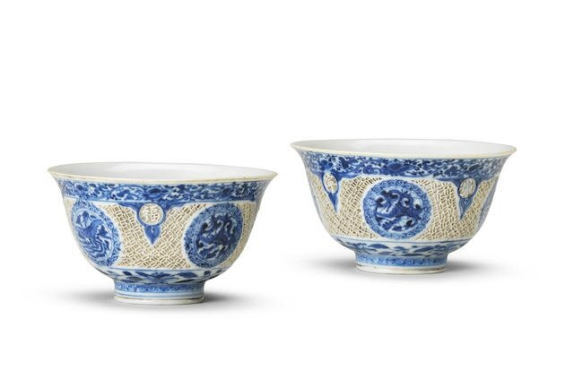 A rare pair of blue and white reticulated cups, Wanli six-character marks and of the period (1573-1619)
