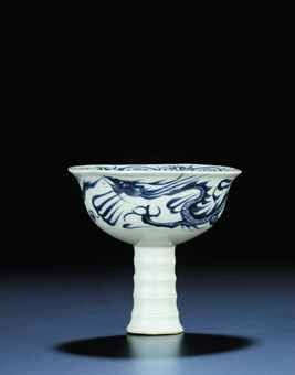 a_very_rare_underglaze-blue_moulded_dragon_stemcup_gaozu_wan_yuan_earl_d5448238h