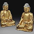 A pair of large gilt-lacquered bronze figures of buddha. ming dynasty, 16th-17th century