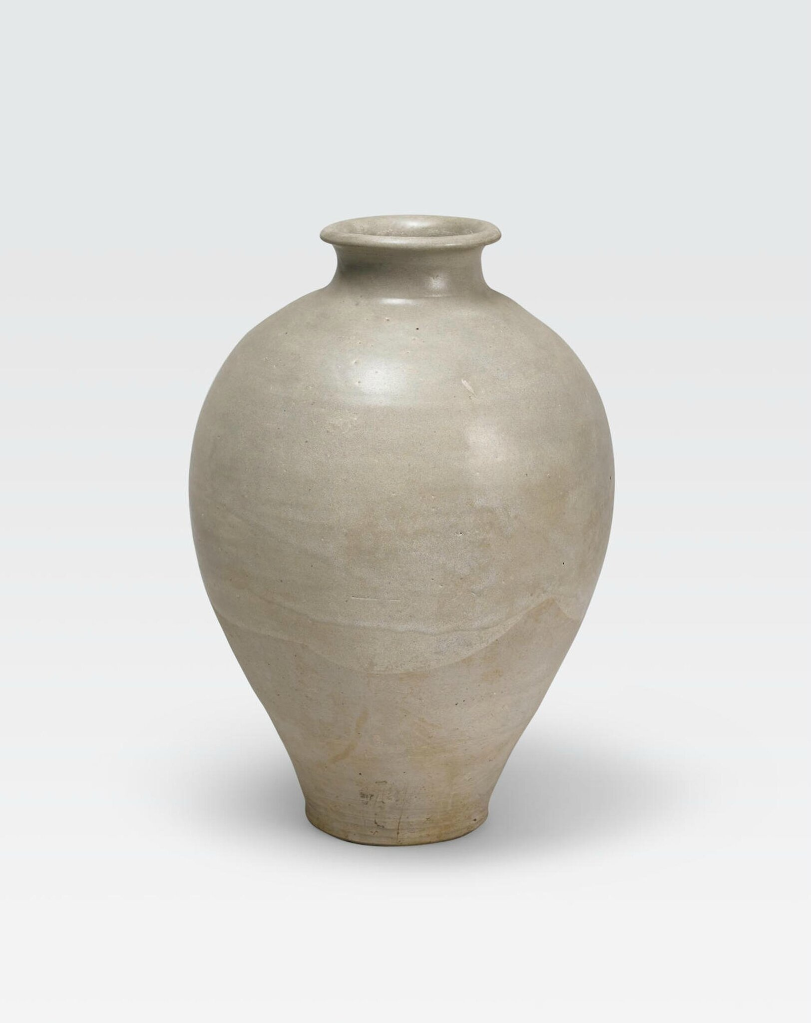 A straw glazed stoneware ovoid jar, Tang dynasty (618-907)