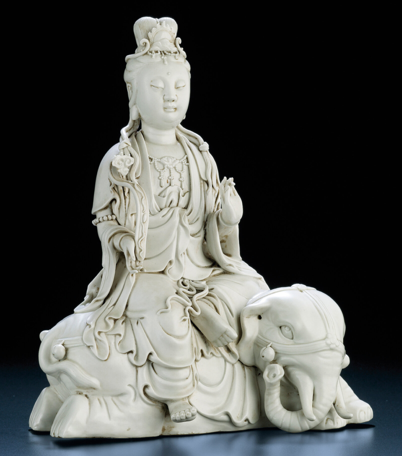 A Dehua seated figure of Samantabhadra, Qing dynasty, late 19th-early 20th century