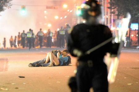 enhanced-buzz-wide-16942-1322857259-92 Australian Scott Jones kisses his Canadian girlfriend Alex Thomas after she was knocked to the ground by a police officer's riot shield in Vancouver, British Columbia