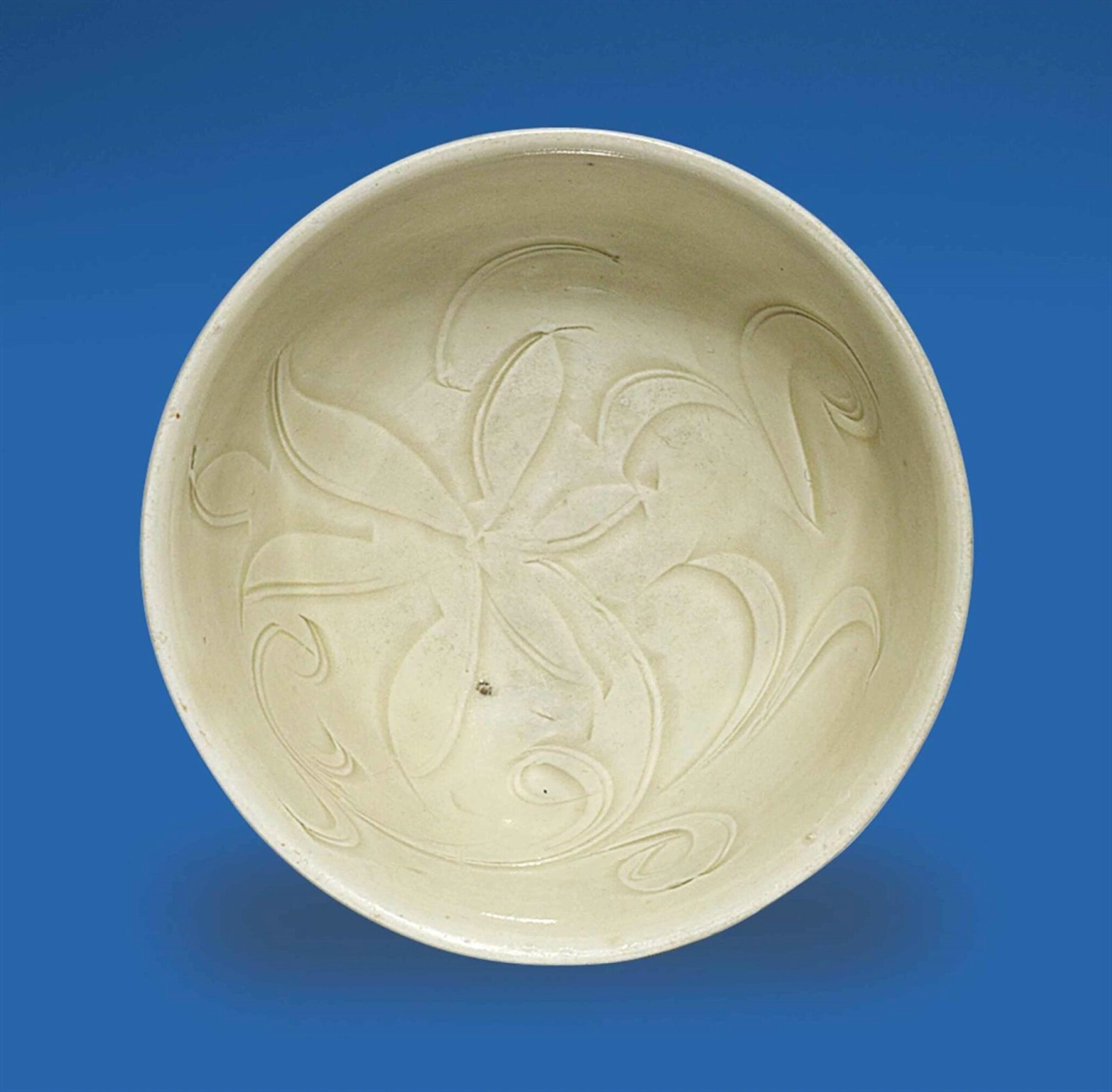 A small carved Ding bowl, Northern Song dynasty, 12th century