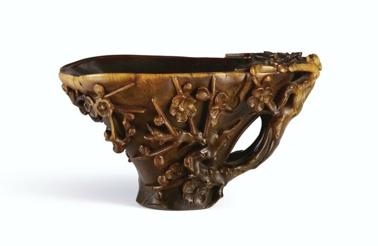 A rhinoceros horn 'Prunus tree' libation cup, Qing Dynasty , 17th-18th century