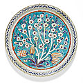 An iznik polychrome pottery dish with a prunus tree, turkey, circa 1575-85