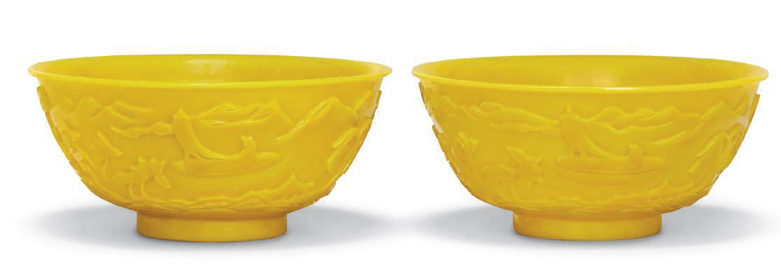 A pair of yellow glass bowls, 19th-20th century