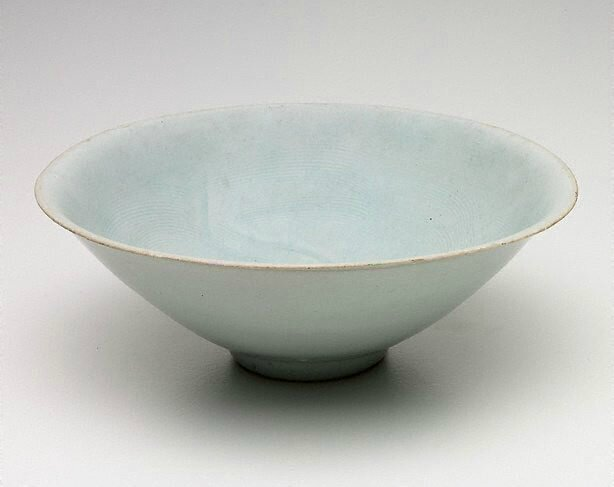 Pair of qingbai conical bowls, 13th century, China, Song dynasty (960 - 1279) - Yuan dynasty (1279 - 1368), porcelain with duck egg blue glaze and incised decoration, 6.6 x 18.4 cm & 6.5 x 18.4 cm. Gift of Dr John Yu and Dr George Soutter 2003. 194.2003.1