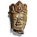 A rare painted limestone head of a bodhisattva, northern zhou-sui dynasty, late 6th century ce