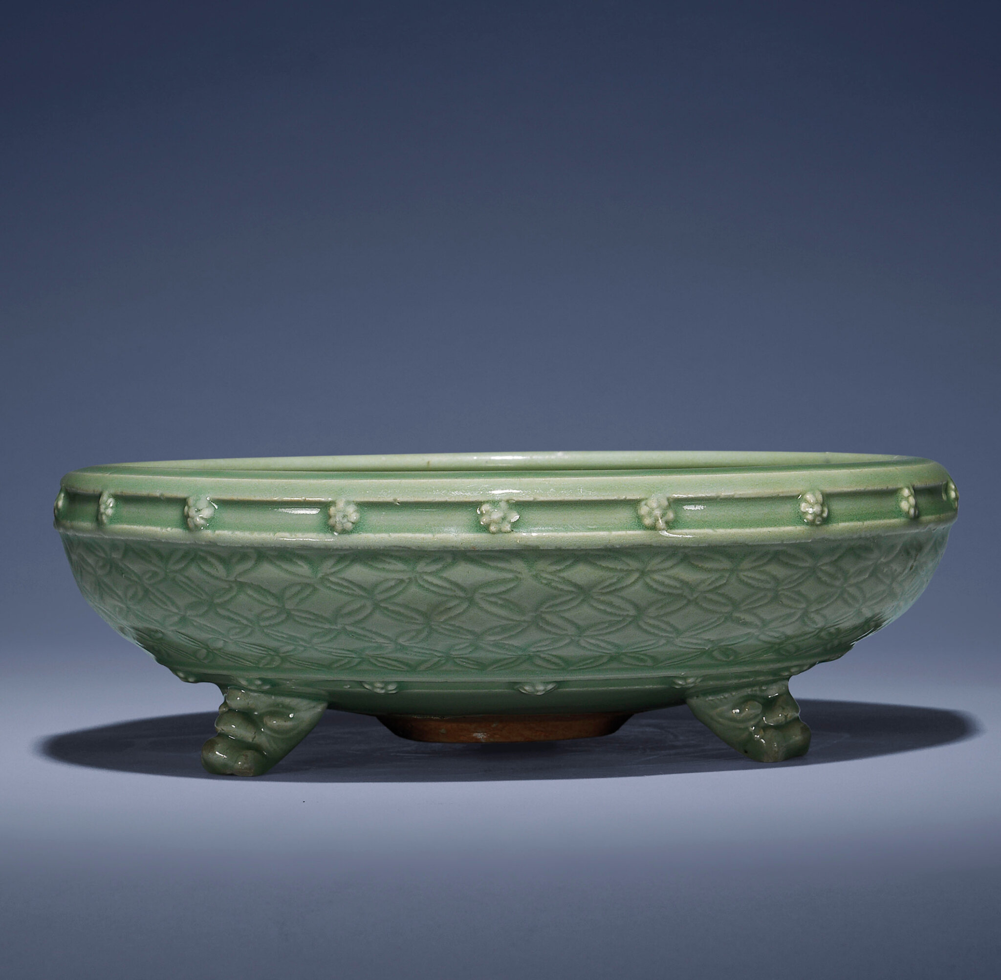 A large carved and moulded Longquan celadon tripod censer, Ming dynasty, 15th century