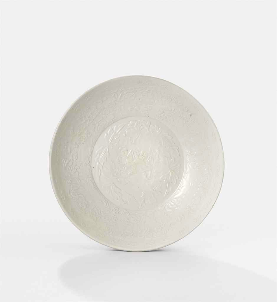 A white-glazed moulded 'boys' bowl, Jin dynasty (1115-1234)