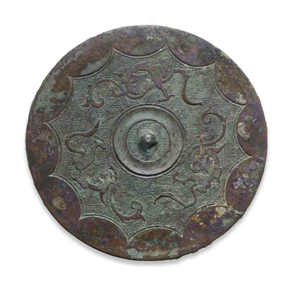A bronze circular 'Dragon and Arc' mirror, Late Warring States Period-Early Western Han dynasty, circa 3rd century BC