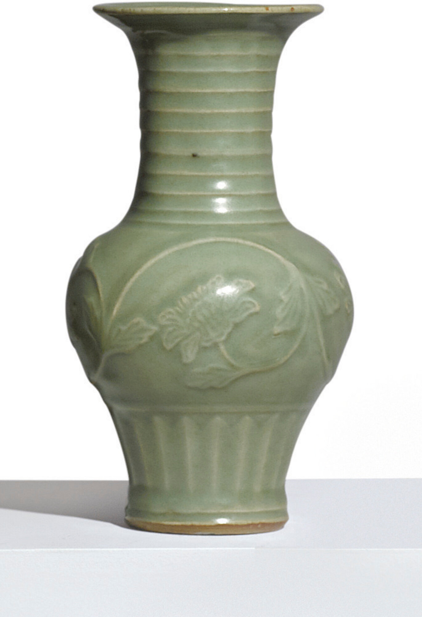 A small 'Longquan' celadon-glazed 'peony' vase, Yuan dynasty