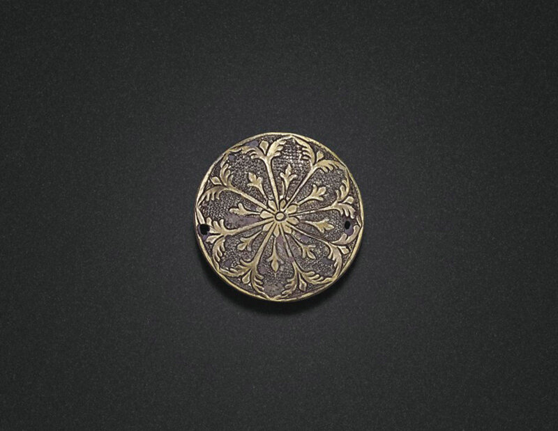 A miniature circular parcel-gilt silver box and cover, Tang dynasty (618-907)