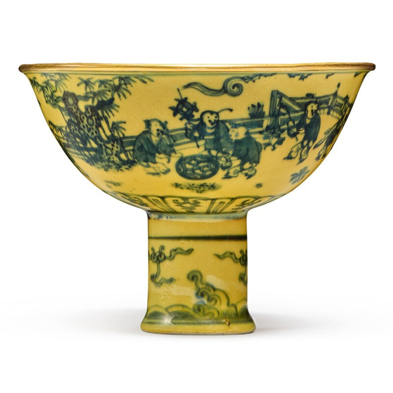 A rare yellow-glazed blue and white 'boys at play' stembowl, Ming dynasty, 15th century