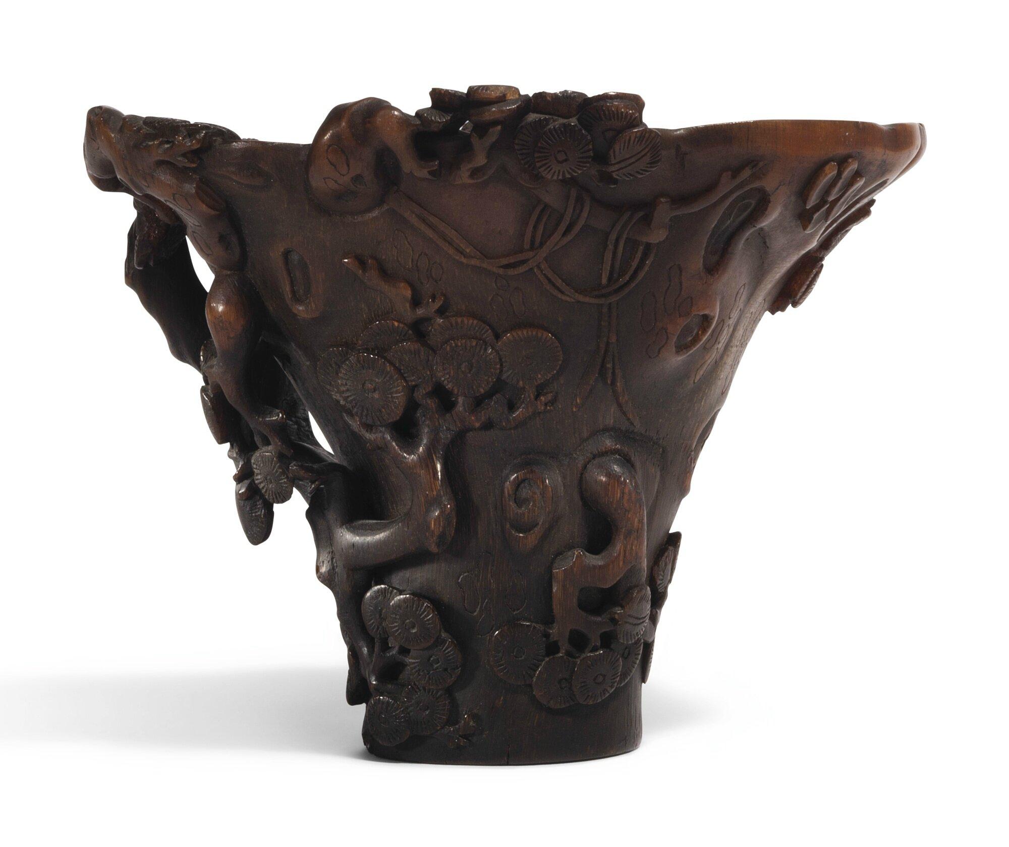 A rhinoceros horn 'pine' libation cup, Qing dynasty, 17th - 18th century