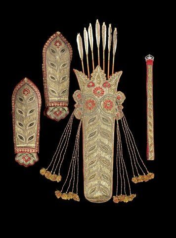 A fine embroidered Quiver and Arm Guards, related Belt and seven decorated Arrows, Mysore, late 18th Century