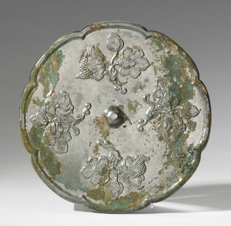 A bronze octalobed 'Flower and Fruit' mirror, Tang Dynasty