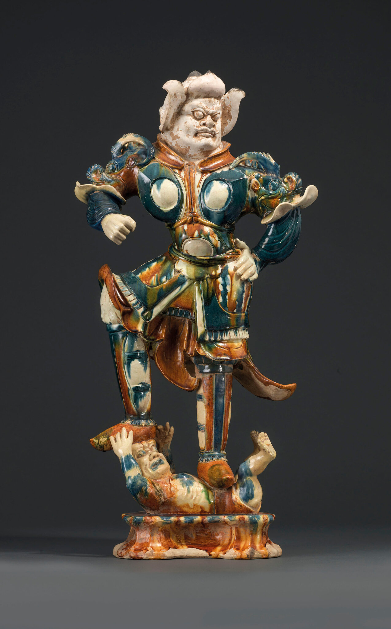 A magnificent sancai and blue-glazed pottery figure of a guardian warrior dating to the Tang Dynasty (618-907)