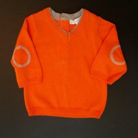 pull orange coudes