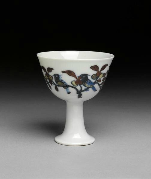 Another view of the stemcup, painted on the outside in underglaze blue and overglaze polychrome enamels in doucai style with two branches with large leaves and fruit and two pairs of birds. Chenghua mark and period (1465-1487), Ming dynasty. Jingdezhen kil