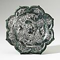 A bronze 'birds and flowers' octafoil mirror, tang dynasty