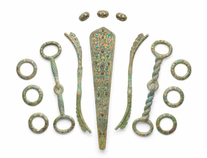A rare set of gold, silver and hardstone-inlaid bronze harness fittings, Eastern Zhou Dynasty (770-256 BC)