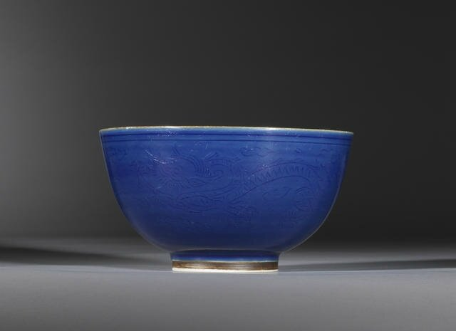 A blue-glazed carved 'dragon' bowl, Late Ming Dynasty. Photo Bonhams.