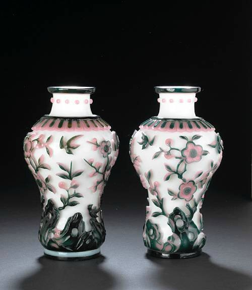 A pair of two-color overlay glass vases. Photo Bonhams