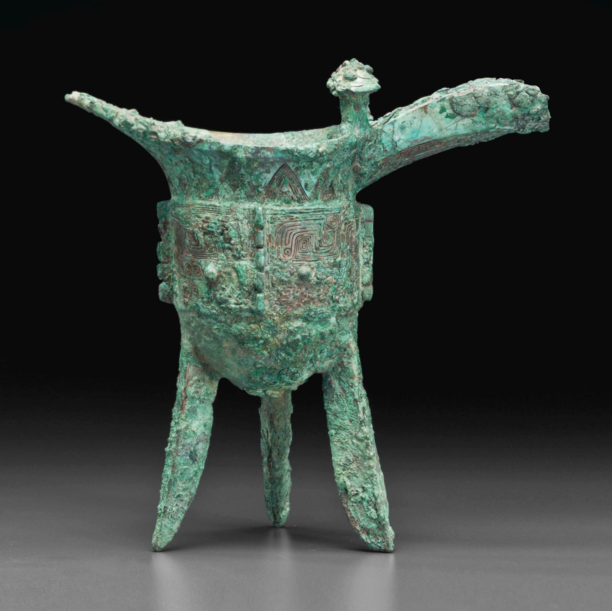 A bronze ritual tripod wine vesse, jue, Late Shang dynasty, 12th-11th century BC