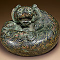 A rare gold and silver-inlaid bronze tiger-form weight, eastern han dynasty (25-220 ad)