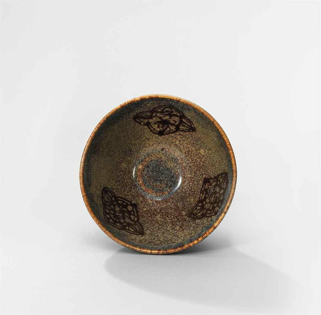 A Jizhou paper-cut resist-decorated tea bowl, Southern Song Dynasty (1127-1279)