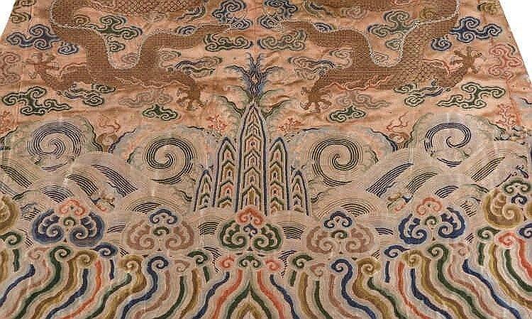 A coral ground silk Tibetan chuba, tailored from 18th century Chinese kesi7