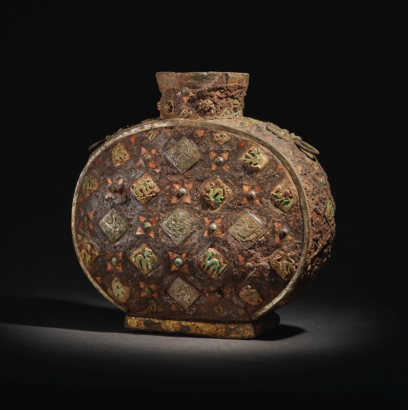 An importantand extremely rare inlaid iron flask, Warring States period - Han dynasty (475 BC–220 AD)