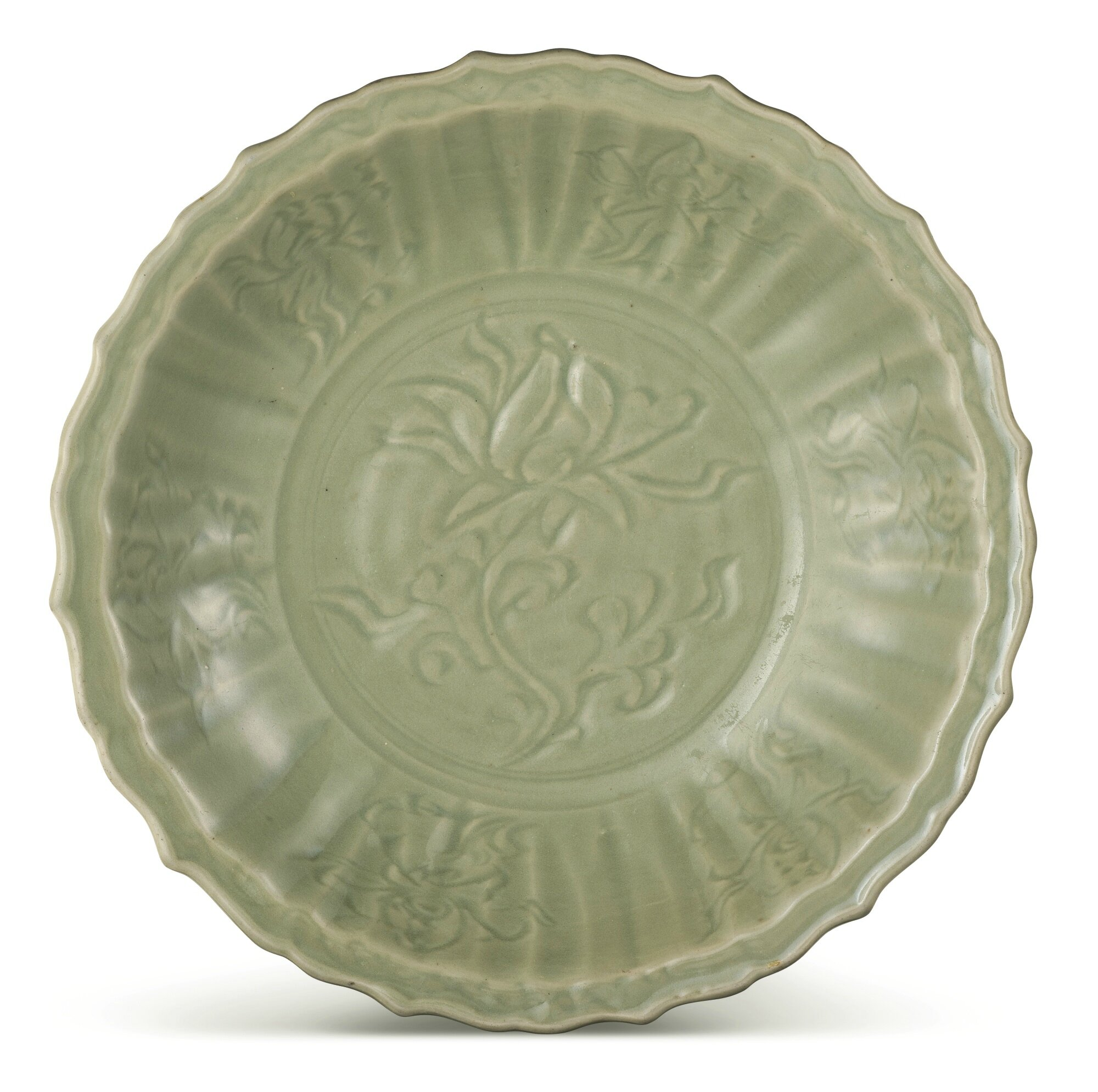 A lobed Longquan celadon carved 'lotus' dish, Yuan-early Ming dynasty