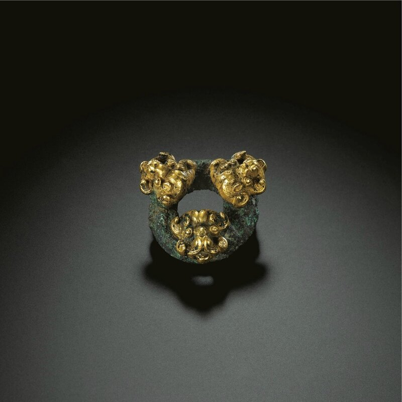 A bronze and gold harness fitting, Warring States Period (475-221 BC)