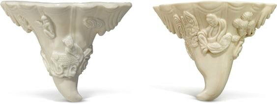 Two 'Dehua' rhinoceros horn-form cups, Late Ming Dynasty