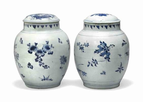 Two large 'Hatcher cargo' blue and white ovoid jars and covers, Transitional, mid-17th century
