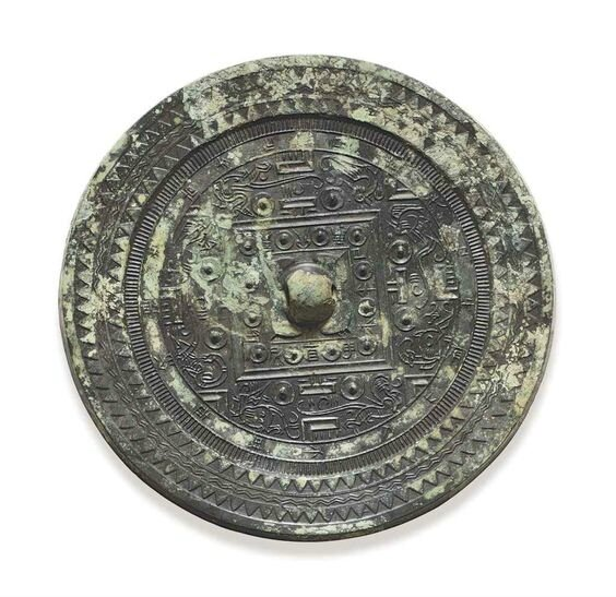 A bronze circular 'TLV' mirror with inscription, Xin-Early Eastern Han dynasty, 1st century