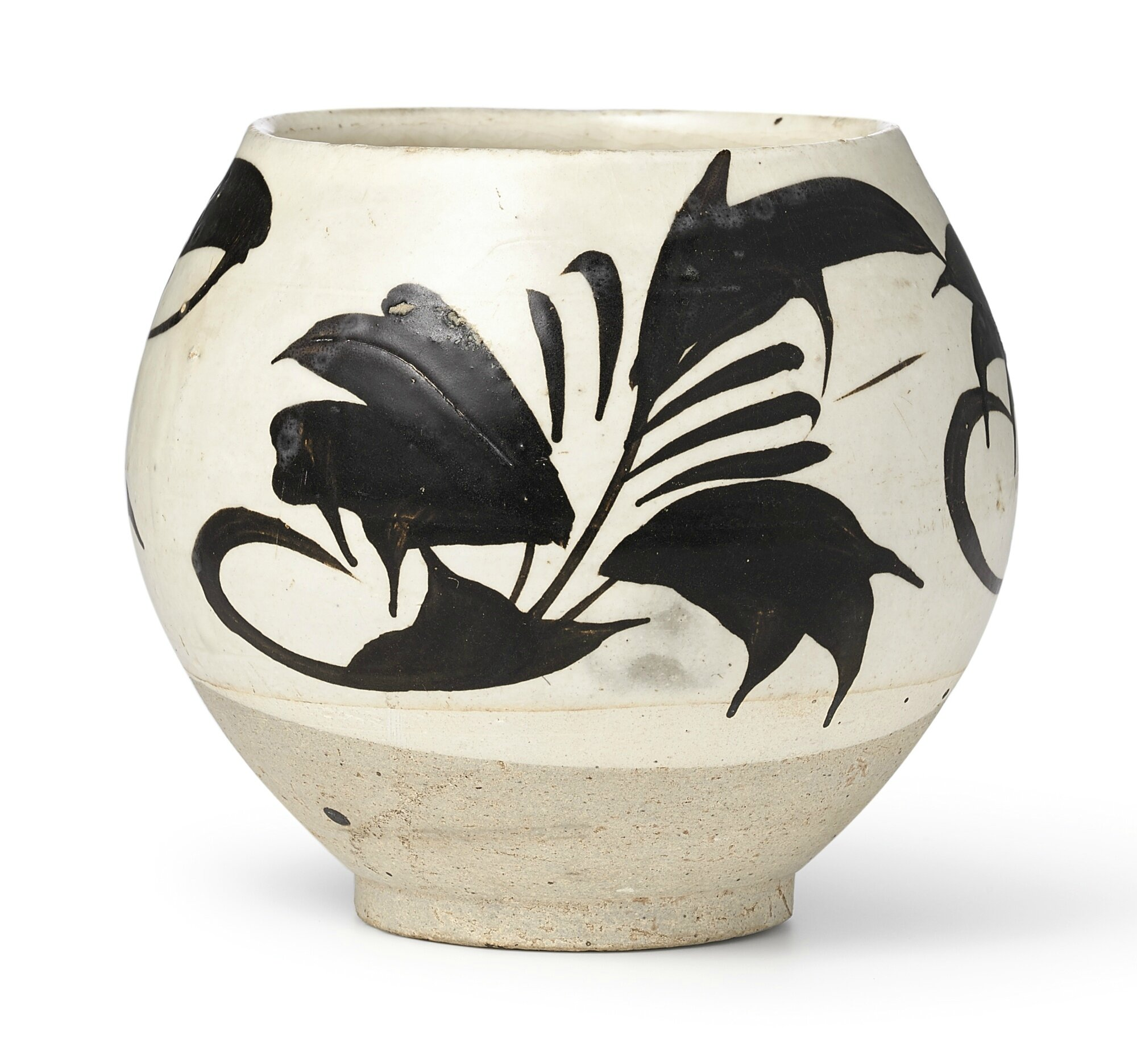 A ''Cizhou' white-ground black-painted 'floral' jar, Northern Song Dynasty (960-1127)
