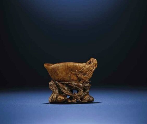 A finely carved peach-form rhinoceros horn libation cup, Late Ming-Early Qing dynasty, 17th century