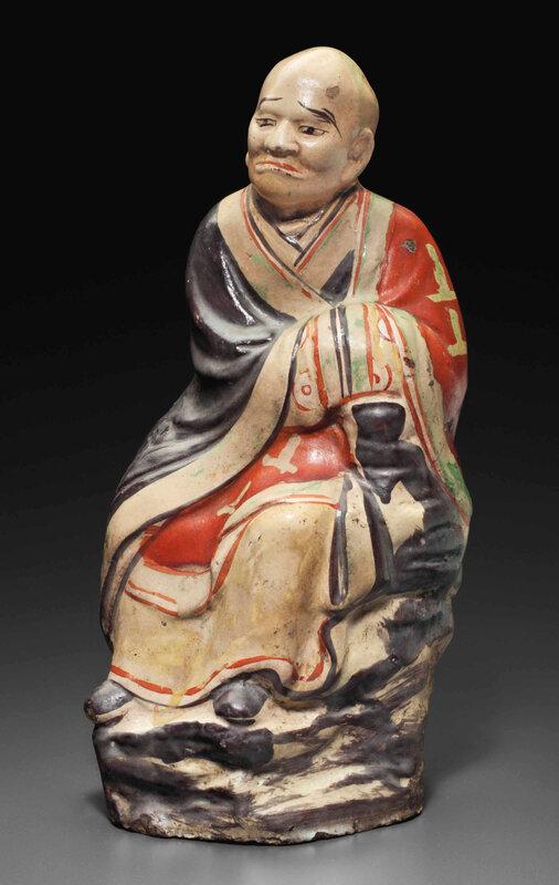 A Cizhou polychromed pottery figure of aluohan, Yuan dynasty (1279-1368)