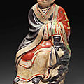 A Cizhou polychromed pottery figure of a luohan, Yuan dynasty (1279-1368)