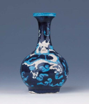 A very rare imperial Fahua bottle vase, Encircled Zhengde four-character mark and of the period (1506-1521)