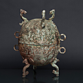 A tall and exceptional bronze vessel 'dui'. china, late eastern zhou-dynasty (770-256 bc)