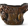 A massive inscribed rhinoceros horn 'Pine Tree' libation cup, 17th century